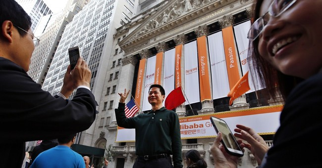 Alibaba stock soars in jubilant trading debut